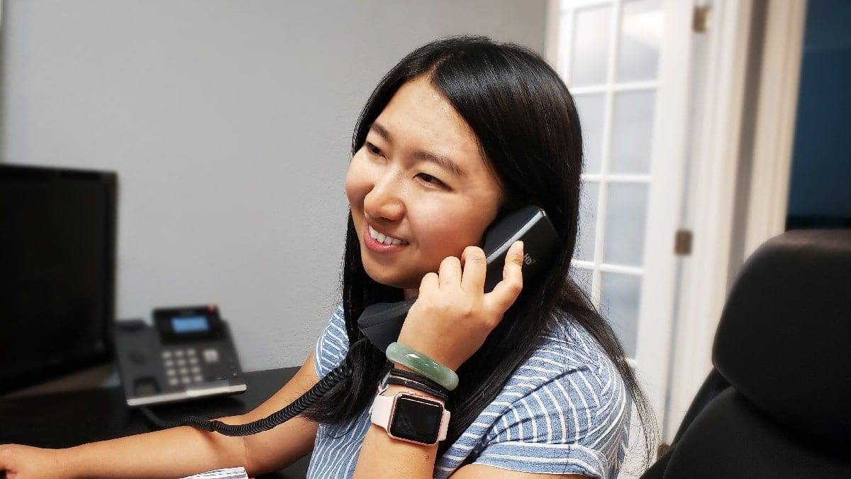 Businesswoman answering the phone for a client